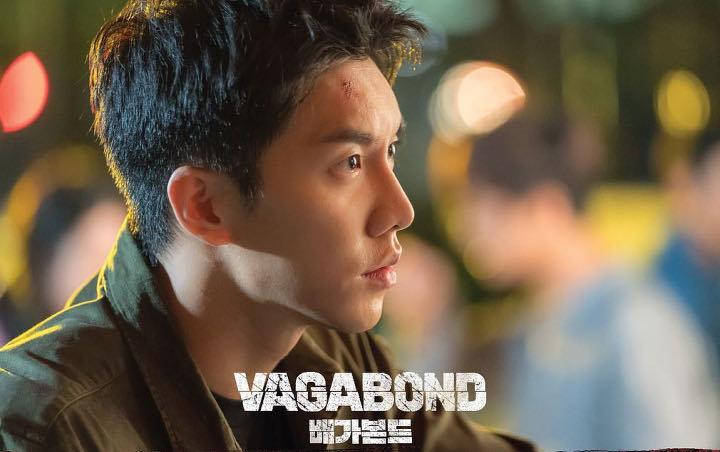 Pegang Pistol, Wajah Lee Seung Gi Penuh Luka di Foto Perdana 'Vagabond'